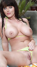 Sophie Dee is a dripping wet knockout in sheer yellow micro bikini